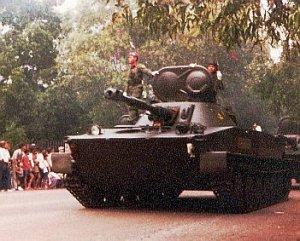PT-76 dalam defile HUT ABRI 1978. Terlihat meriam belum mengalami retrofit