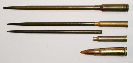 Peluru paku APS dengan peluru reguler (bawah)