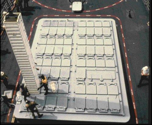 Sistem loading rudal pada kapal perang dengan peluncur VLS
