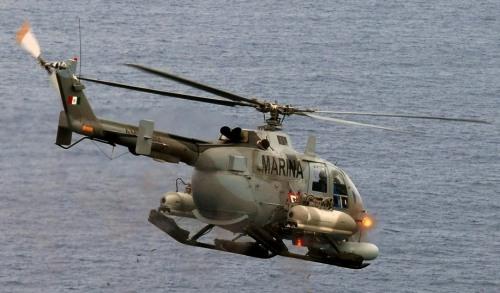 Beginilah aksi FN HMP saat sedang mengumbar proyektil, sayang NBO-105 tidak dilengkapi sista ini