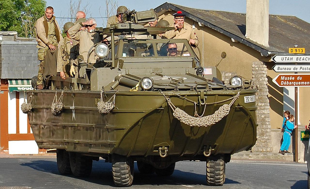 an-american-dukw-an-amphibious-truck-rolls-through-sainte-marie-du-mont-photo-310440-s-1280x782
