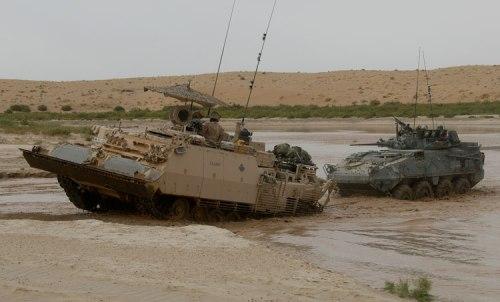 ARV 3 Buffalo Kanada menarik ranpur LAV di Afghanistan.